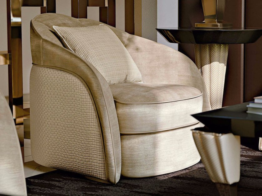 Upholstered leather lobby chair STARDUST | Armchair by Turri