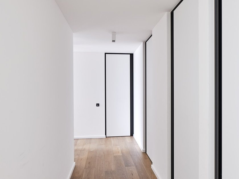 HPL pivot door with vertical aluminium RGP handle SVD BKO by Anyway Doors