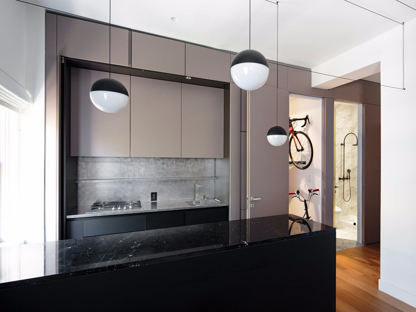 Hideaway steel and stone kitchen with peninsula T45   Steel kitchen by TM Italia Cucine