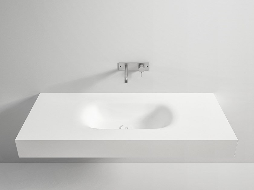 Wall-mounted Corian® washbasin with integrated countertop TERMOFORMATO | Washbasin by Rexa Design