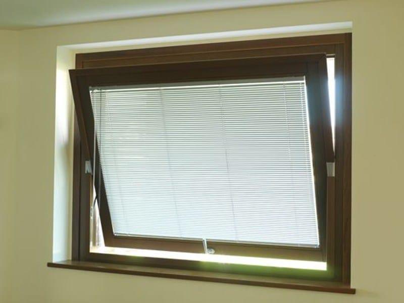 Aluminium and wood horizontally pivoted window VENICE 90 | Window by CARMINATI SERRAMENTI