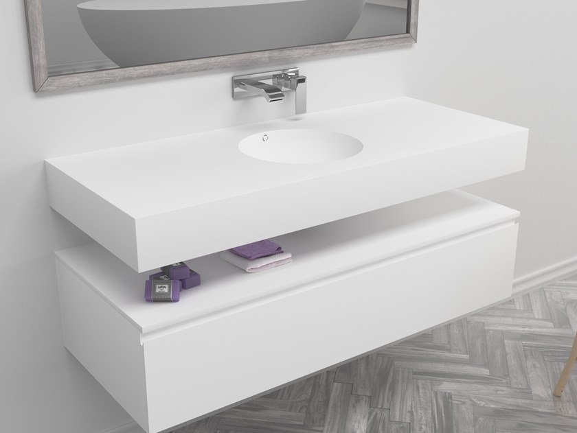 Round single wall-mounted Corian® washbasin RELAX | Single washbasin by RILUXA
