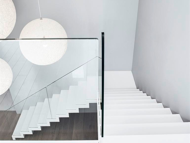 L-shaped Corian® Open staircase ZIG-ZAG CORIAN by Siller Treppen