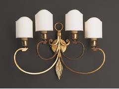 Lampada da parete fatta a mano in ferro battutoFRECCIA | Lampada da parete in ferro battuto - OFFICINACIANI DI CATERINA CIANI & CO.