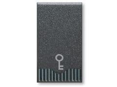 Pulsante uolpolarePulsante Pulsante 1P 10A NA simbolo chiave | Noir S45 - AVE
