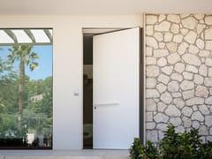 Porta blindata a bilico con rivestimento in Corian biancoSYNUA   Porta ingresso in Corian Bianco - OIKOS VENEZIA
