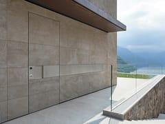 Porta d'ingresso blindata con rivestimento in pietraTEKNO | Porta d'ingresso in pietra - OIKOS VENEZIA