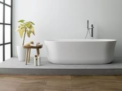 Vasca da bagno centro stanza ovale in Krion®ARC - PORCELANOSA GRUPO