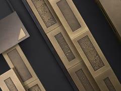 DE CASTELLI, CIPHER Rivestimento modulare in metallo