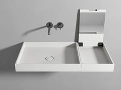 Lavabo in Corian® con consolle truccoLAVABO CON CONSOLLE TRUCCO - REXA DESIGN