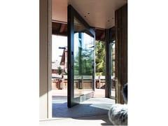 Porta a bilico vetrata con finitura in alluminioNOVA   Porta d'ingresso vetrata a bilico - OIKOS VENEZIA