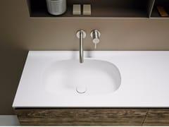 Lavabo in Corian® con piano OVALO -