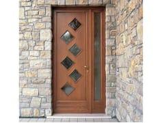 Porta d'ingresso in pino per esterno con pannelli in vetroPorta d'ingresso in pino - CARMINATI SERRAMENTI