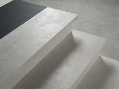Rivestimento per scale in gres porcellanatoRivestimento per scale in gres porcellanato - DECORATORI BASSANESI