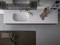 Lavabo ovale in Corian® con pianoMOODE | Lavabo con piano - REXA DESIGN