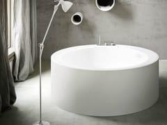 Vasca da bagno centro stanza rotonda in Corian® HOLE | Vasca da bagno rotonda - Hole