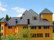 Rivestimento di copertura con scandole metalliche modulari