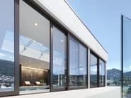 Porta-finestra alzante scorrevole in alluminio e legno