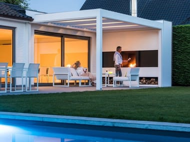 Motorized pergola with built-in lights & open fireplace CAMARGUE®