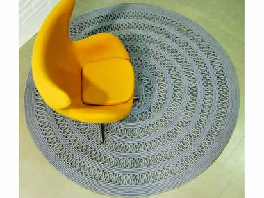 Solid-color round rug CAYMAN