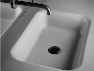 Single Cementsolid washbasin with integrated countertop FLOAT | Cementsolid washbasin