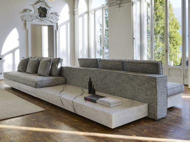 Statuary marble sofa with integrated magazine rack INFINITY