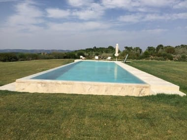 Infinity travertine swimming pool with waterfall Infinity swimming pool
