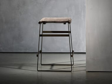 Upholstered sled base stool with footrest KEKKE LIVING | Stool