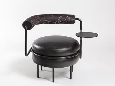 Upholstered leather easy chair with integrated magazine rack MACARON