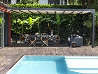 Wall-mounted motorized fabric pergola with sliding cover PACCHETTO STYLE