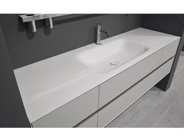 Corian® washbasin with integrated countertop SEGNO
