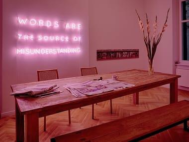 Wall-mounted neon light installation SILENCE