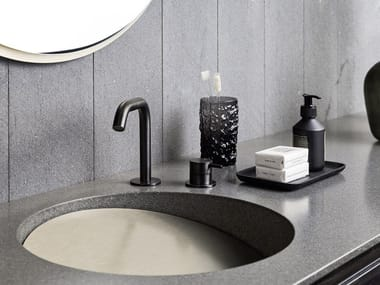 Round single Corian® washbasin with integrated countertop SLOPE