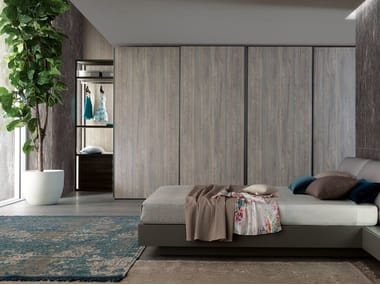 Sectional wardrobe with sliding doors TECNO WOOD | Wardrobe with sliding doors