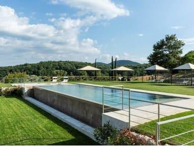 Infinity Semi Inground swimming pool with waterfall TREQUANDA