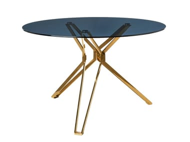 Round glass and steel living room table Glass and steel table