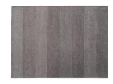 Solid-color rectangular rug WAVES
