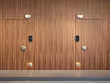 Door flush with the wall in wood with home automation system WELCOME