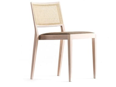 Beech chair with integrated cushion and cane backrest A CHAIR OUTSIDE THE CAGE