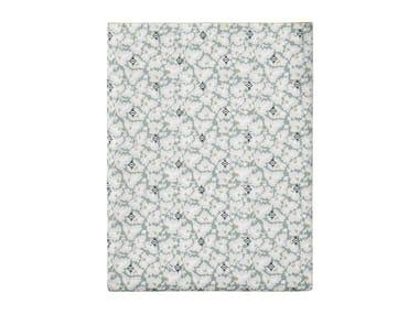 Lenzuola stampato in cotone con motivi floreali FEUILLES D'IKAT | Lenzuola