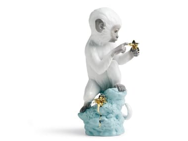 Porcelain decorative object CURIOSITY MONKEY ON TURQUOISE ROCK