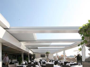 Wall-mounted aluminium pergola with folding louvers FOLD | Wall-mounted pergola