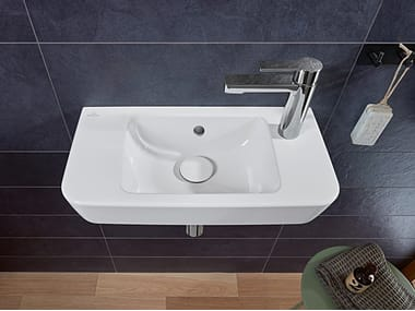 Rectangular wall-mounted ceramic handrinse basin with overflow O.NOVO | Handrinse basin