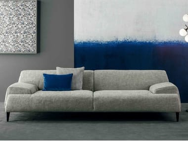 Leather sofa with removable cover with integrated magazine rack CAVE | Sofa