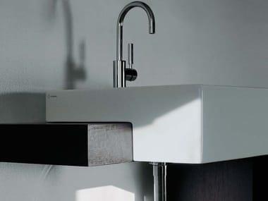 Semi-inset ceramic washbasin with overflow ACQUAGRANDE 60 | Semi-inset washbasin