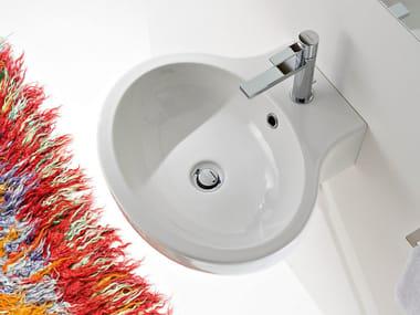 Oval wall-mounted ceramic washbasin PLANET | Washbasin