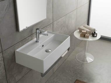 Wall-mounted ceramic washbasin TEOREMA 60X35R