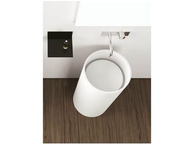 Freestanding round Corian® washbasin TOWER ROUND