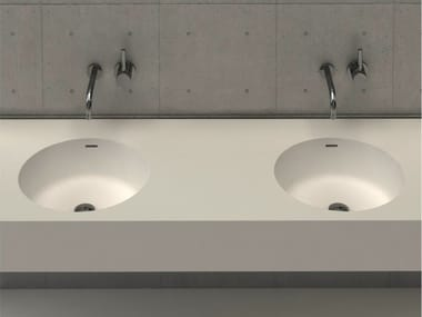 Round wall-mounted washbasin with integrated countertop CIRCLE DESK D