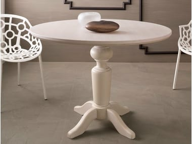 Wooden living room table with 4-star base Round table
